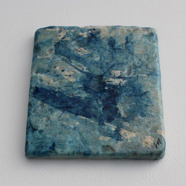 Art coaster close up of ocean blue design