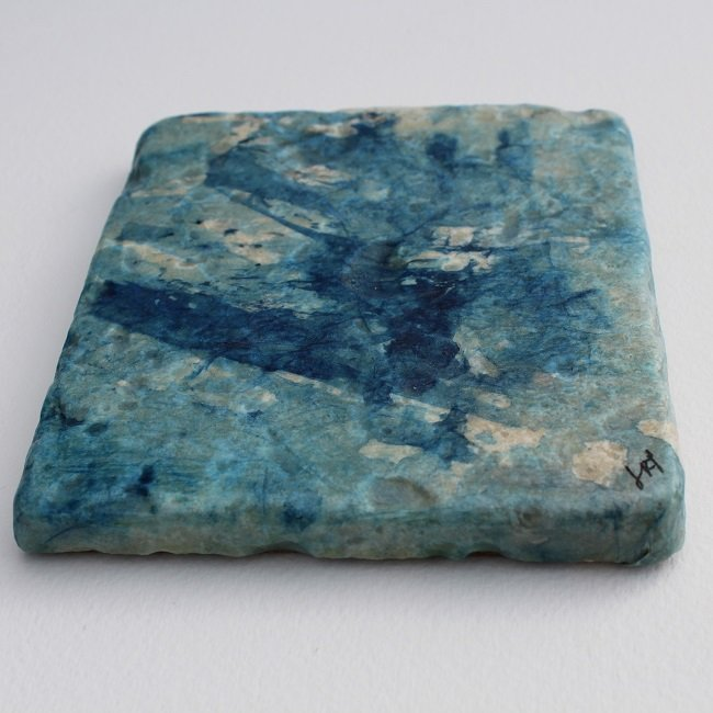 Art coaster close up of ocean blues