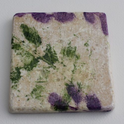 Art coaster with purple flowers and green leaves